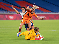 YOKOHAMA, JAPAN - JULY 30: Carli Lloyd #10 of the USWNT is defended by Jackie Groenen #14 of the Netherlands as Sari van Veenedaal #1 makes a save during a game between Netherlands and USWNT at International Stadium Yokohama on July 30, 2021 in Yokohama, Japan.