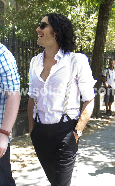 **ALL ROUND PICTURES FROM SOLARPIX.COM**.**SYNDICATION RIGHTS FOR UK, AUSTRALIA, DENMARK, PORTUGAL, S. AFRICA, SPAIN & DUBAI (U.A.E) & ASIA (EXCLUDING JAPAN) ONLY**.Arthur Filming in the East Village of New York, USA, 12 July 2010.This pic: Russell Brand..JOB REF: 11664     PHZ mayer   DATE: 12_07_2010.**MUST CREDIT SOLARPIX.COM OR DOUBLE FEE WILL BE CHARGED**.**MUST NOTIFY SOLARPIX OF ONLINE USAGE**.**CALL US ON: +34 952 811 768 or LOW RATE FROM UK 0844 617 7637**