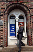 A Customer at the Bank of Shanghai, Shanghai.