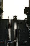 A San Francisco cable car make its way down California Street.