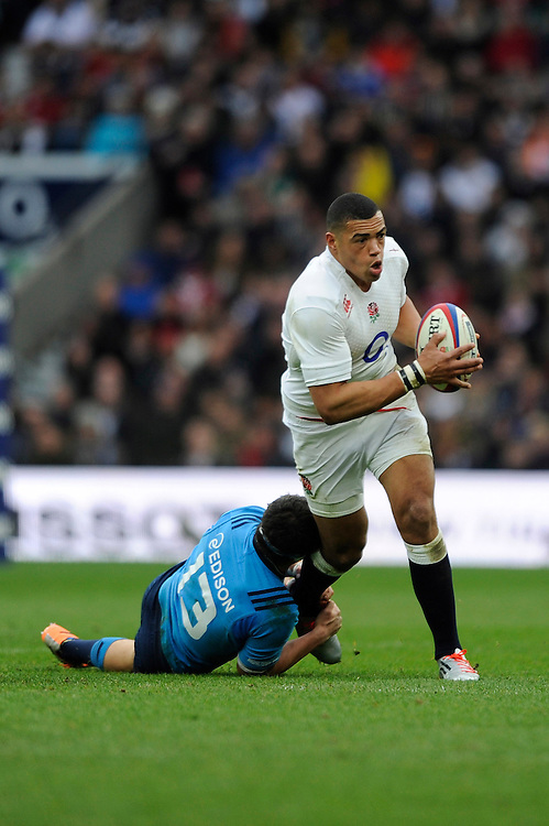 Luther Burrell of England is tackled by Luca Morisi of Italy during the RBS 6 Nations match between England and Italy at Twickenham Stadium on Saturday 14th February 2015 (Photo by Rob Munro)