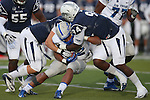 Air Force's Broam Hart (32) gets tackled by Nevada's Jordan Dobrich (49) and Lenny Jones (94) during the first half of an NCAA football game in Reno, Nev., on Saturday, Sept. 28, 2013. (AP Photo/Cathleen Allison)