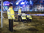 """© Joel Goodman - 07973 332324 . 20/12/2014 . Manchester , UK . Police tend to a vomiting man with a head injury outside Deansgate Locks nightclub venue . An ambulance took over 40 minutes to arrive . """" Mad Friday """" revellers out in the rain and cold in Manchester . Mad Friday is typically the busiest day of the year for emergency services , taking place on the last Friday before Christmas when office Christmas parties and Christmas revellers enjoy a night out .  Photo credit : Joel Goodman"""