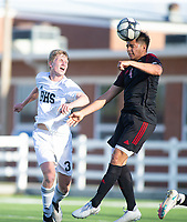 Sivestre Martinez (4) of Springdale heads the ball in front of Andrew Wagner (3) of Bentonville at Jarrell Williams Bulldog Stadium, Springdale, Arkansas, on Wednesday, April 7, 2021 / Special to NWA Democrat Gazette David Beach