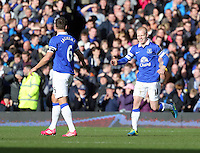 Pictured: Steven Naismith of Everton (R) celebrating his goal with team mate Phil Jagielka (L), making the score 2-1 to his team.  Sunday 16 February 2014<br /> Re: FA Cup, Everton v Swansea City FC at Goodison Park, Liverpool, UK.