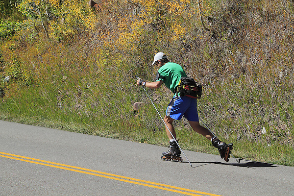 Caucasian male rollerblading, inline skating, on Trail Ridge Road in Rocky Mountain National Park, west of Estes Park, Colorado, USA