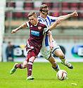 Hearts' Sam Nicholson and Killie's Jeroen Tesselaar challenge for the ball.