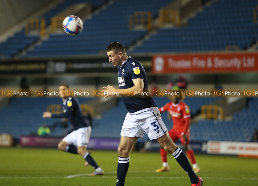 Murray Wallace of Millwall heads the ball away during Millwall vs Nottingham Forest, Sky Bet EFL Championship Football at The Den on 19th December 2020