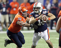 ATLANTA, GA - DECEMBER 31: Jake Snyder #90 of the Virginia Cavaliers puts pressure on Barrett Trotter #14 of the Auburn Tigers during the 2011 Chick Fil-A Bowl at the Georgia Dome on December 31, 2011 in Atlanta, Georgia. Auburn defeated Virginia 43-24. (Photo by Andrew Shurtleff/Getty Images) *** Local Caption *** Barrett Trotter;Jake Snyder