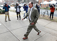 CHARLOTTESVILLE, VA - FEBRUARY 17: George Huguely IV, the father of George Huguely, walks past reporters outside the Charlottesville Circuit courthouse where his son is on trial. Huguely was charged in the May 2010 death of his girlfriend Yeardley Love. She was a member of the Virginia women's lacrosse team. Huguely pleaded not guilty to first-degree murder. (Credit Image: © Andrew Shurtleff