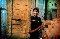 "12 year old Gopal lives in a slum in Delhi. The T-shirt he is wearing says: ""I'll find a place of my own."" Gopal dreams of finding a place of his own. ."