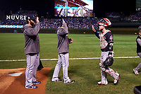 Cleveland Indians catcher Roberto Perez (55) high fives teammates before Game 4 of the Major League Baseball World Series against the Chicago Cubs on October 29, 2016 at Wrigley Field in Chicago, Illinois.  (Mike Janes/Four Seam Images)