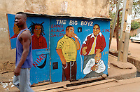 Mali. Bamako. A small shop sells music tapes. Drawing on the walls of american rappers like, 2 Pac, The Big Oyz, Notorious Big.  © 1997 Didier Ruef
