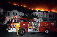 870000325 la county firemen fight to protect private homes in agoura as the topanga wildfire flares up on a nearby ridge in los angeles county california