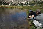 Woman and man fishing at Lawn Lake on a summer morning in Rocky Mountain National Park, Colorado, USA, model release #93