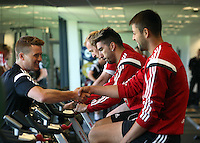 Pictured: Lukasz Fabianski (R) is greeted by a physiotherapist. Wednesday 02 July 2014<br /> Re: Pre-season testing during the first day of training for Swansea City FC players at the Landore training ground.