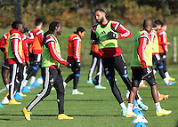 Pictured L-R: Marvin Emnes, Kyle Bartley and Dwight Tiendalli Wednesday 05 November 2014<br /> Re: Swansea City FC players training at Fairwood training ground, ahead of their Premier League game against Arsenal on Sunday.