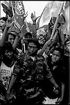 Summer '99-- Jakarta, Indonesia --  Security guards hold back a crowd during a rally. Political life is tough on the world's most inhabited island in the world's biggest muslim nation.