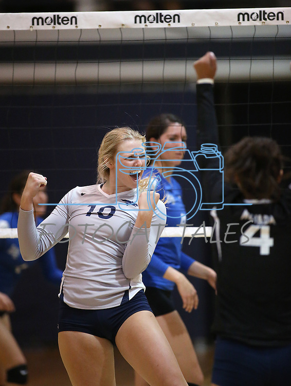 Nevada's Sam Willouoghby (10) and Kara Kasser (4) celebrate a point against Air Force during college volleyball action in Reno, Nev., on Thursday, Sept. 25, 2014. Air Force won 3-2.<br /> Photo by Cathleen Allison