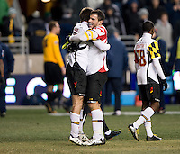 Patrick Mullins (15) of Maryland celebrates the win with teammate Jake Pace (20) after the NCAA Men's College Cup semifinals at PPL Park in Chester, PA.  Maryland defeated Virginia, 2-1.