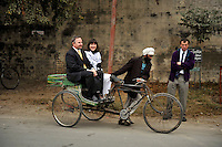 Guests of the bride are cycled from one venue to another for the wedding ceremony of British/Punjabi couple Lindsay and Navneet Singh at a gurdwara in Amritsar.