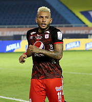BARRANQUILLA-COLOMBIA, 14-10-2020: Duvan Vergara de America de Cali, celebra el gol anotado a Atletico Junior, durante partido entre Atletico Junior y America de Cali, de la fecha 14 por la Liga BetPlay DIMAYOR 2020 jugado en el estadio Metroplitano Roberto Melendez de la ciudad de Barranquilla. / Duvan Vergara of America de Cali, celebrates the scored goal to Atletico Junior, during a match between Atletico Junior and America de Cali of the 14th date for the BetPlay DIMAYOR Leguaje 2020 played at the Metroplitano Roberto Melendez Stadium in Barranquilla city. / Photo: VizzorImage / Jairo Cassiani / Cont.