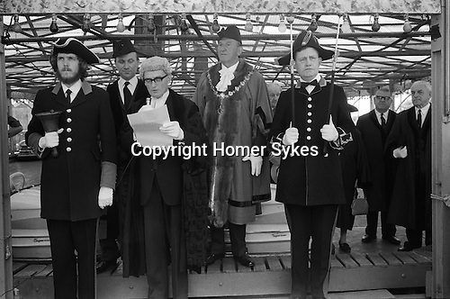 Southwold Trinity Fair, Southwold, Suffolk, England 1973. The Opening of the Charter Fair.<br /> Mayor George Cockerill attends the opening of the annual Trinity Monday Charter Fair. Traditional the Charter  is read by the town clerk from the steps of one of the amusement rides. In 1973 the fair was declared open from the steps of the dodgem cars.<br /> <br /> George Cockerill Mayor of Southwold from 1972 -1974.