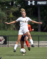 Boston College midfielder Kristen Mewis (19) attempts to control the ball as defender pressures. Boston College defeated University of Virginia, 2-0, at the Newton Soccer Field, on September 18, 2011.