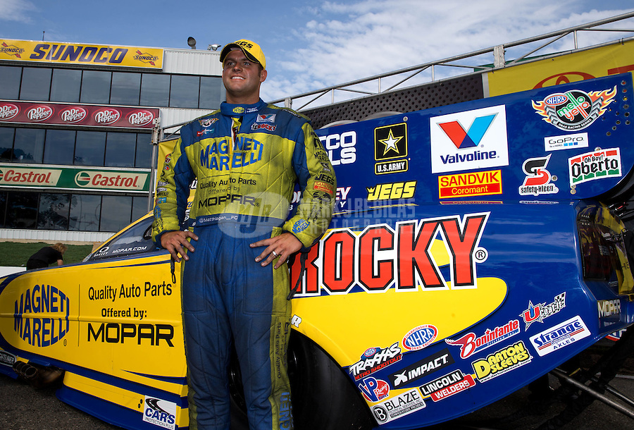 Jun. 2, 2013; Englishtown, NJ, USA: NHRA funny car driver Matt Hagan celebrates after winning the Summer Nationals at Raceway Park. Mandatory Credit: Mark J. Rebilas-