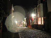 Rye in UK by Art Harman. Walking in fine mist down the hill in Rye on England's southern coast, I was taken by the scene on this cobblestone road. A droplet landed on my lens, transforming the photo to an evocative moment.