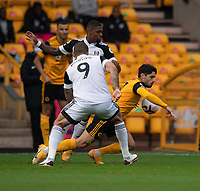 \Wolverhampton Wanderers' Pedro Neto (right) battles through as he is tackled by Fulham's Ivan Cavaleiro & Aleksandar Mitrovic <br /> <br /> Photographer David Horton/CameraSport<br /> <br /> The Premier League - Wolverhampton Wanderers v Fulham - Sunday 4th October 2020 - Molineux Stadium - Wolverhampton<br /> <br /> World Copyright © 2020 CameraSport. All rights reserved. 43 Linden Ave. Countesthorpe. Leicester. England. LE8 5PG - Tel: +44 (0) 116 277 4147 - admin@camerasport.com - www.camerasport.com