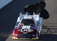 Feb. 22, 2013; Chandler, AZ, USA; NHRA funny car driver Tim Wilkerson during qualifying for the Arizona Nationals at Firebird International Raceway. Mandatory Credit: Mark J. Rebilas-