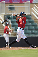 Tyler Frost (1) of the Kannapolis Intimidators follows through on his swing against the Greensboro Grasshoppers at Kannapolis Intimidators Stadium on August 5, 2018 in Kannapolis, North Carolina. The Grasshoppers defeated the Intimidators 2-1 in game one of a double-header.  (Brian Westerholt/Four Seam Images)