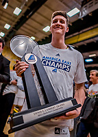 16 March 2019: University of Vermont Catamount Forward Bailey Patella, a Sophomore from Lenox, MA, holds the Denis Lamber trophy after a victory over the UMBC Retrievers in the America East Championship Game at Patrick Gymnasium in Burlington, Vermont. The Catamounts defeated the Retrievers 66-49, avenging their loss against the same team in last years' Championship Game. Mandatory Credit: Ed Wolfstein Photo *** RAW (NEF) Image File Available ***