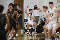 Bentonville forward Harrison Hicks (15) reacts, Saturday, November 14, 2020 during a basketball game at Bentonville High School in Bentonville. Check out nwaonline.com/201115Daily/ for today's photo gallery. <br /> (NWA Democrat-Gazette/Charlie Kaijo)