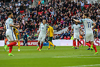 Jamie Vardy (Leicester City) of England (19) celebrates with Kyle Walker (Tottenham Hotspur) of England (left) and Adam Lallana (Liverpool) of England (right) after he scores his team's second goal of the game to make the score 2-0 during the International World Cup Qualifier match between England and Lithuania at Wembley Stadium, London, England on 26 March 2017. Photo by David Horn / PRiME Media Images.