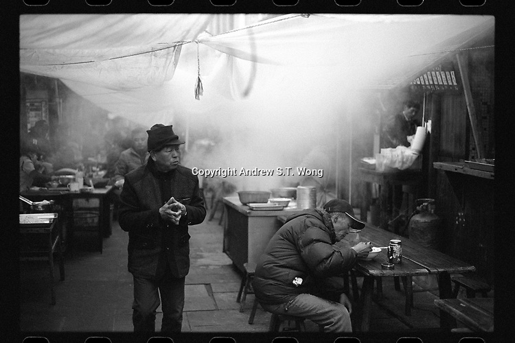 Youbu Township, Lanxi City, Zhejiang Province - Local residents enjoy breakfast at old tea houses early in the morning, December 2020., The ancient township of Youbu is located along the Qiantang River.