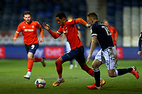 23rd February 2021; Kenilworth Road, Luton, Bedfordshire, England; English Football League Championship Football, Luton Town versus Millwall; Thomas Ince of Luton Town competes for the ball with Alex Pearce of Millwall