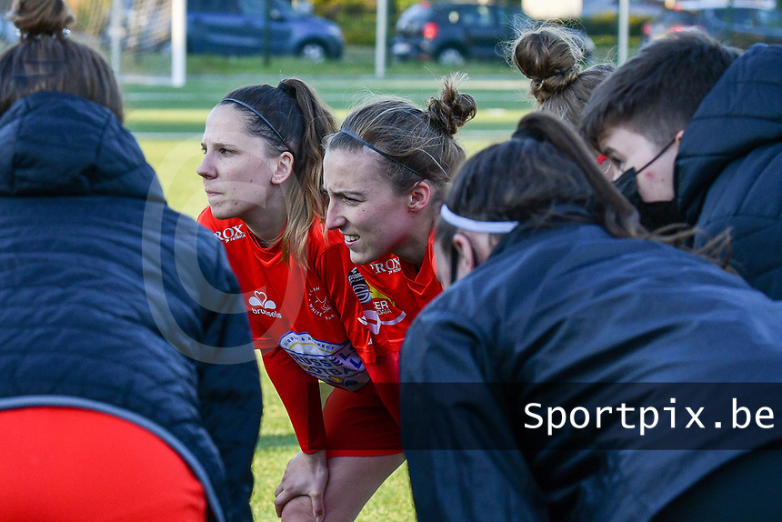 Taika De Koker (16) of Woluwe and Selina Gijsbrechts (11) of Woluwe pictured during the huddle before a female soccer game between  Racing Genk Ladies and White Star Woluwe on the 8 th matchday of play off 2 in the 2020 - 2021 season of Belgian Scooore Womens Super League , tuesday 18 th of May 2021  in Genk , Belgium . PHOTO SPORTPIX.BE | SPP | JILL DELSAUX