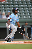 First baseman Tyreque Reed (38) of the Hickory Crawdads follows through on a swing during a game against the Greenville Drive on Monday, August 20, 2018, at Fluor Field at the West End in Greenville, South Carolina. Hickory won, 11-2. (Tom Priddy/Four Seam Images)