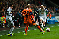 Thursday 28 November  2013  Pictured: Jonjo Shelvey gets the ball past Jeremy Mathieu of Valencia<br /> Re:UEFA Europa League, Swansea City FC vs Valencia CF  at the Liberty Staduim Swansea