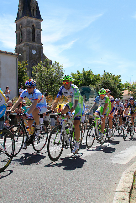The pelethon including Liquigas-Cannondale's Ivan Basso (ITA) and Katusha's Pavel Brutt (RUS) pass through the town of Vaire during the 3rd Stage of the 2011 Tour de France, 198k from Olonne-sur-Mere to Redon, 4th July 2011 (Photo by Eoin Clarke/NEWSFILE)