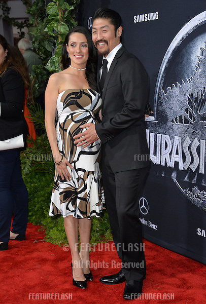 """Brian Tee & wife Mirelly Taylor at the world premiere of his movie """"Jurassic World"""" at the Dolby Theatre, Hollywood.<br /> June 10, 2015  Los Angeles, CA<br /> Picture: Paul Smith / Featureflash"""