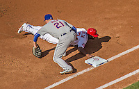 6 April 2015: Washington Nationals outfielder Michael Taylor dives safely back to first on a pickoff attempt in the first inning of the Home Opening Game against the New York Mets at Nationals Park in Washington, DC. The Mets rallied to defeat the Nationals 3-1 in their first meeting of the 2015 MLB season. Mandatory Credit: Ed Wolfstein Photo *** RAW (NEF) Image File Available ***