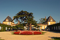 The court yard to Chateau Beychevelle in Saint Julien. Beautiful flower arrangements and huge cedar tree