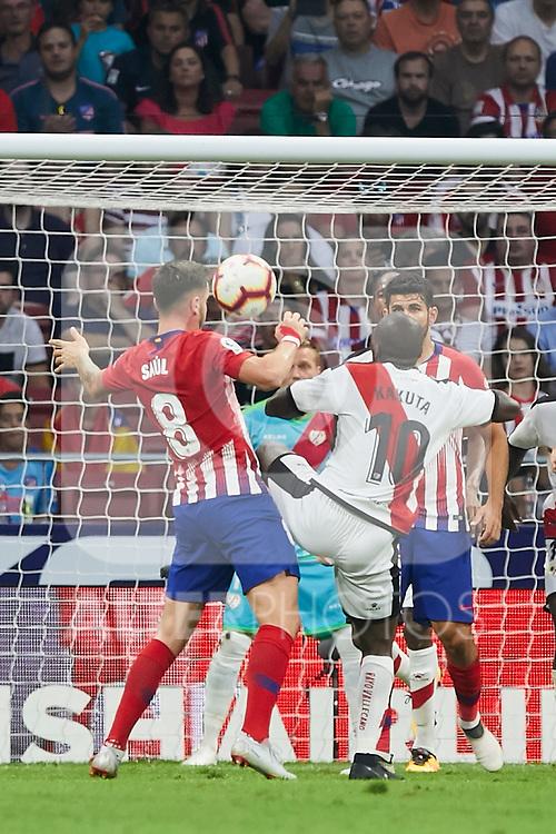 Atletico de Madrid's Saul Niguez and Rayo Vallecano's Gael Romeo Kakuta during La Liga match. August 25, 2018. (ALTERPHOTOS/A. Perez Meca)