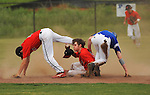 WCA second baseman Seth Gossett trips over shortstop Matt Hale who hold on to the ball to get Mars Hill's Will Myhamn out at second base to end the inning.  Mars Hill at Westminster Christian Academy baseball playoff.   Bob Gathany / The Huntsville TImes