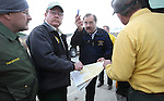 Carson City Fire Chief Stacey Giomi, center, talks to officials at the command post of the Laurel fire which was burning 150-200 east of Carson City, Nev., on Friday, Dec. 30, 2011. Initially the fire threatened about two dozen homes before being pushed east by high winds. Photo by Cathleen Allison