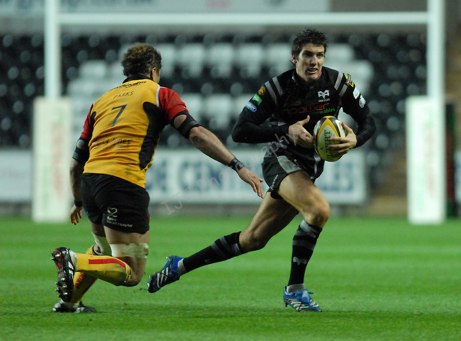 James Hook on the attack with Richard Parks closing in. Swansea Neath Ospreys Vs Newport Gwent Dragons, Magners league, Liberty Stadium © IJC Photography. Photographer Ian Cook