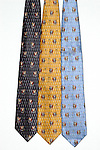 """Guy Buffet 100% Silk Tie<br /> """"Golf All Over""""<br /> $75 includes shipping in Continental US<br /> Specify Color; Dark Grey, Gold or Blue<br /> Limited quantities."""